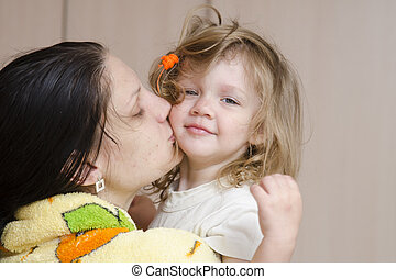 Mom hugs and kisses awakened fuzzy- - Mom keeps on handles...