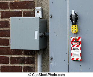 electrical lock out tag placed on a breaker panel