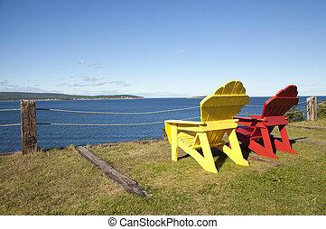chairs overlooking ocean