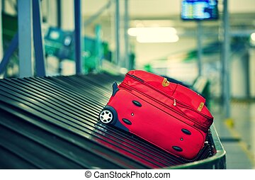 Baggage sorting - Baggage on conveyor belt at the airport -...