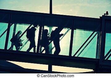 Boarding bridge - Passengers are walking in boarding bridge...