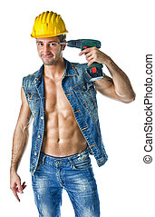 Handsome, muscular construction worker pointing drill against head