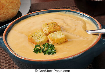 Lobster bisque with parsley garnish - A bowl of lobster...