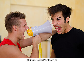 Personal trainer motivating client yelling with megaphone