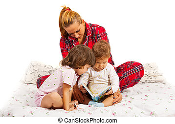 Mother reading a bedtime story to her kids