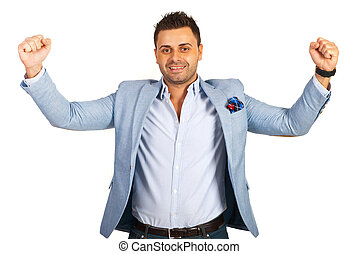 Excited casual businessman with arms in the air isolated on...