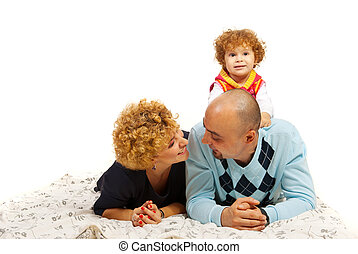 Happy family home lying together on blanket