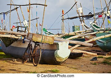 Port - Bicycle and fishing boats in port - Sri Lanka