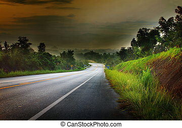 nature scene of asphalt road run into the mountain in...