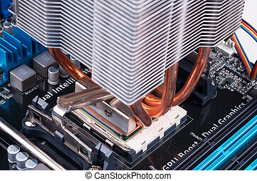 PC Mainboard - CPU and cooler with heatpipes mounted on PC...