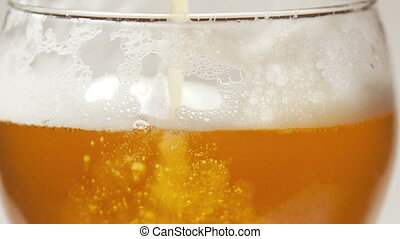 Beer foam and bubbles in the glass