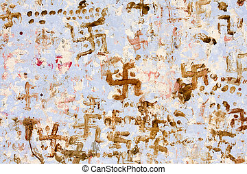 Swastika in Indian temple, Pushkar. - Swastika on the wall...