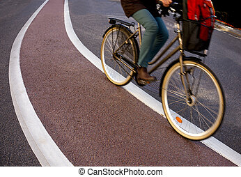 Cyclist in blurred motion on bicycle lane