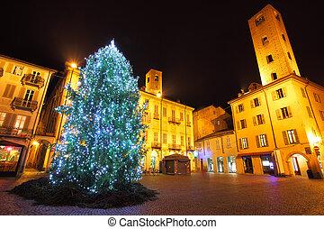 Christmas tree on central plaza. Alba, Italy. - Illuminated...