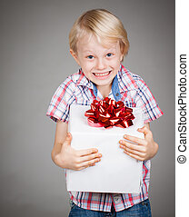 Very happy boy holding present