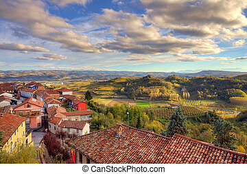 Small town among hills Piedmont, Italy - View on red tiled...