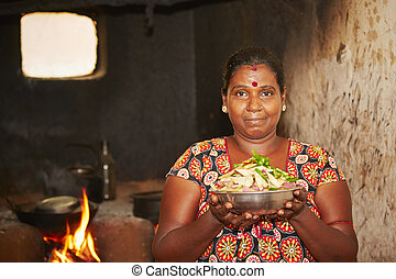 Ancient kitchen - Woman is preparation food in ancient...