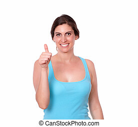 Attractive woman standing with thumb up
