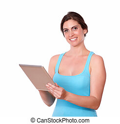 Smiling young woman using tablet pc