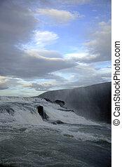 Fast flowing Gulfoss - Fast flowing waterfall Gulfoss in...