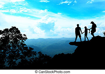 Silhouette Family - Family silhouette at the cliff and...