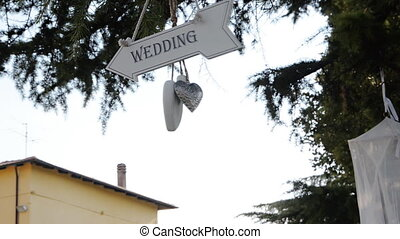 wedding sign turning and showing where the reception is