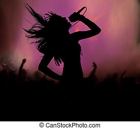 Female singer silhouette at rock concert