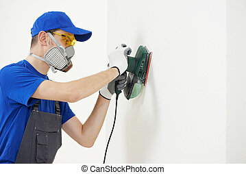 worker with orbital sander at wall filling - Home...