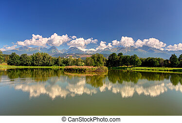Tatra mountain with reflection in lake - panoramic view