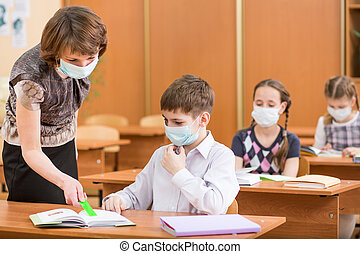 school kids and teacher with protection mask against flu...