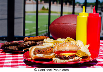 Tailgating Meal - Tailgating meal with cheeseburger, hot...