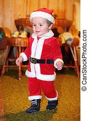 Cute kid in Santa Claus clothes