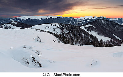 Sunset in winter mountain with dramatic sky - panoramic view...