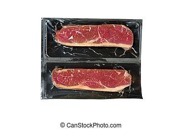 strip loin steak in plastic wrap - isolated strip loin steak...