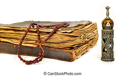 Muslim rosary on the koran - Holy Quran, prayer beads and...