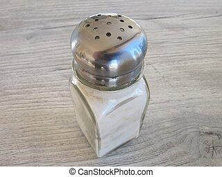 Salt shaker on rustic table