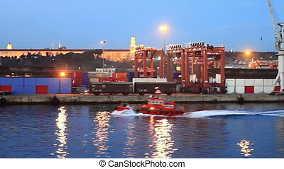 Tug boat in sea port - A red tug boat cruising in the harbor...