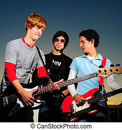 Young musical band - Portrait of young trendy musicians...