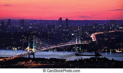 Bosphorus, Istanbul - Illimunated bridge traffic at sunset...