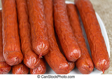 Bavarian sausages on a white plate close-up