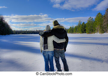 a couple overlooking snow field in Algonquin Park. - Dreamy...