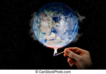 Global Warming a hand holding a match warming the globe