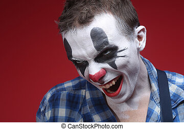 Spooky Clown Portrait on Red Background - Evil Spooky Clown...