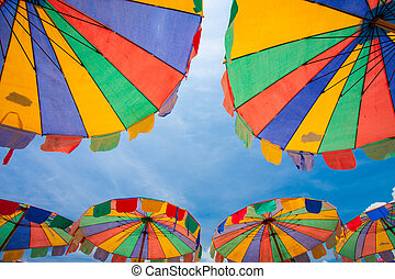 Colorful beach umbrellas with clear blue sky