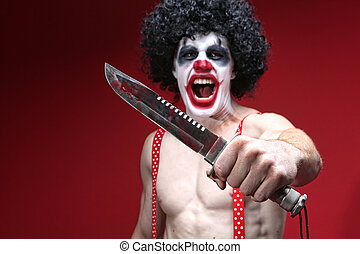 Spooky Clown Holding a Bloody Knife - Evil Spooky Clown...
