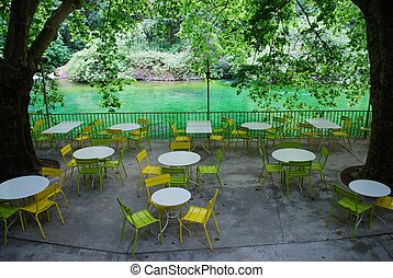 Fontaine de Vaucluse, France - Tables and chairs on outdoor...