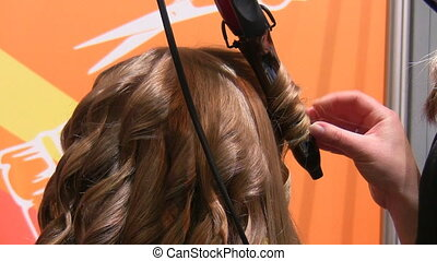Curl making - Hair stylist making curls on customer hair...
