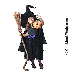little witch shows the collected candy in pumpkin