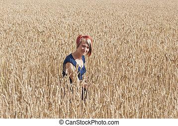 Girl in a field of wheat.