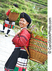 smiling chinese minority woman Yao - Group of happy chinese...
